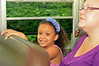 Walton Farm Elementary School hosted K-Day, an opportunity for kindergartners to become familiar with  how to safely board and  ride on a school bus.   Evie Smith rides with her mother.   Thursday,  August 7, 2014.   Photo by Geoff Patton