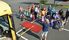 Trainer/driver Kathy Steytler reviews  school bys safety procedures during K-Day at Walron Farm Elementary School.  Thursday,  August 7, 2014.   Photo by Geoff Patton