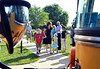 Youngsters approach a school bus at Walton Farm Elementary School on K-Day,  Thursday,  August 7, 2014.   Photo by Geoff Patton