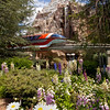 THE MATTERHORN AND THE MONORAIL — The Disneyland Mark VII Monorail passes in front of Matterhorn Bobsleds, surrounded by lush trees and colorful flowers in Fantasyland at Disneyland Park in Anaheim, Calif.<br /> (Paul Hiffmeyer/Disneyland Resort)