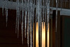 Icicles lit from behind by our front porch lights.  February 5, 2013