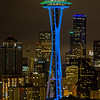 Seattle Space Needle lit in blue and green