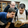 New seminarians tour ancient texts and the rare book room in Fr. Harry's class during spirituality week.