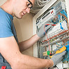 electrician make connections in main electical panel