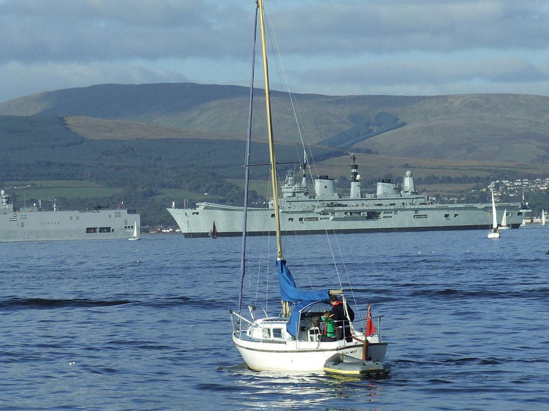 Sight seeing boat with HMS Ark Royal (R07) in the background