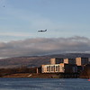 A Flybe de Havilland Canada DHC-8-402Q Dash 8 crossing the River Clyde as it approaches Glasgow Airport. Taken from the Clyde walkway in Renfrew. In the background is Yoker and to the right is the fuel tanks at Rothesay Dock at Clydebank.