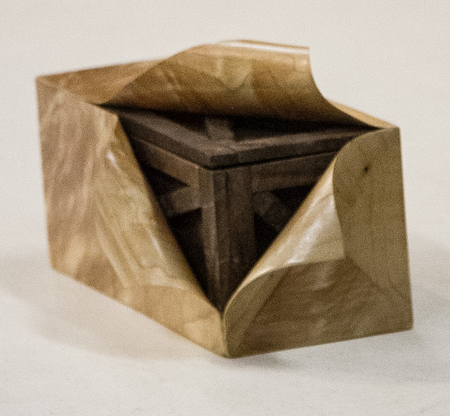 Tom Whalley brought a unique walnut box that appeared to be inside gift wrapping that was peeled back. The wrapping was really veneer. Sep 2014