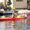 kayakers paddle through