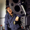Newburyport: Screening Room owner Andrew Mungo with one of the two 35 millimeter projectors. Bryan Eaton/Staff Photo