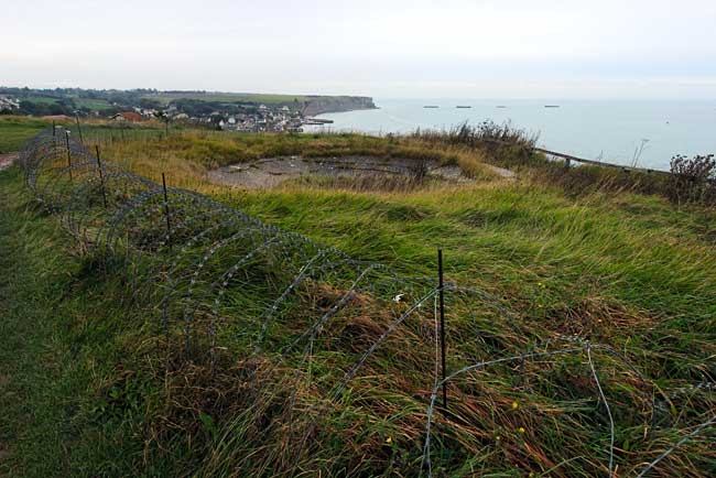 Bomb craters and caissons surround town of Arromanches, France