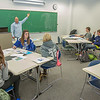 Faculty member Dave Veazey leads a mock geography class during an Inside Out event in a Gruening Building classroom.