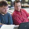 Assistant professor Thane Magelky, right, works with freshman James Griffin in his drafting technology class in the CTC center downtown.