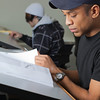 Anthony Rogers reads through the textbook in his drafting class in UAF's Community and Technical College.