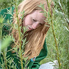 School of Natural Resources and Agricultural Sciences graduate student Haley McIntyre measures willows in a plot under cultivation on UAF's experiment farm. She's helping to monitor the growth of native plant species for their potential use as biomass fuels.