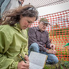 Amanda Byrd, a research technician with the Alaska Center for Energy and Power, works with Steven Sparrow, dean of UAF's College of Natural Resources and Agricultural Sciences, to collect data on a plot of willows being grown on the experiment farm to study their potential use as a source of biofuel. A group of ACEP interns look on.