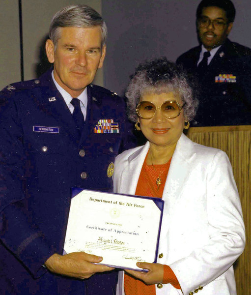 Colonel Herrington presented Afriquita a Certificate of Achievement during my retirement ceremony in 1988.