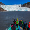 Visitors to the Kenai Fjords National Park marvel at Holgate Glacier during a cruise into the park from nearby Seward.