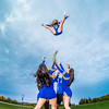 UAF cheerleaders practice in front of the SRC on the Fairbanks campus.