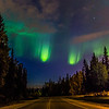 The northern lights appear in the eastern sky above North Tanana Drive on the Fairbanks campus early on a September morning.