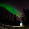 The aurora borealis dances across the night sky above UAF's campus.