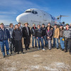 UAF students, staff, faculty amd officials with FedEx post in front of the donated 727 jet at its new home on the east ramp of the Fairbanks International Airport.