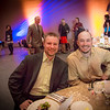UAF alum and Olympic medalist Matt Emmons, left, poses with UAF rifle coach Dan Jordan during the annual Gold Dinner held at the University of Alaska's Museum of the North. Emmons was honored for his role as commencement speaker for the class of 2013.