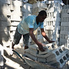 Haiti Delmas PRODEPUR men bricks wheelbarrow