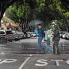 A trio walks across State Street in the rain on Tuesday, Dec. 30, 2014, in Redlands. (Photo by Micah Escamilla/Redlands Daily Facts)