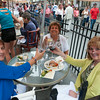 DESI SMITH/Staff photo.    From left to right, Pat Kelcher from Kingston,Ma, Marie Hulak from Hanson, Ma and Pat Ciaramitaro of Gloucester, toast each other while dining out at Passports,during the Annual Main Street Block Party Saturday night.  July 19,2014