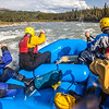 Participants in a UAF Outdoor Adventures day-long raft trip paddle down the Nenana River.