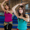 (left to right) Heather Butler and Ellen Mitchell learn how to middle eastern dance in one of the recreation classes offered at the student rec center on campus.