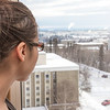 A resident of Moore Hall checks out the view from the 8th floor on a winter afternoon.
