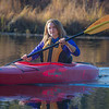 Business major Shelby Carlson enjoys a morning paddle on Ballaine Lake.