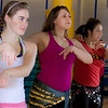 (left to right) Katheryn Zimmerman, Heather Butler and Adriana Amaya learn how to middle eastern dance in one of the recreation classes offered at the student rec center on campus.