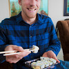 Joe Hunner eats some of the sushi available at the Wood Center food court for lunch.