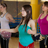 (back left to right) Katheryn Zimmerman, Heather Butler and Ellen Mitchell (front) learn how to middle eastern dance in one of the recreation classes offered at the student rec center on campus.