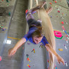 Graduate student Stephany Jeffers practices her silk climbing skills in the SRC.