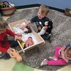 May 14, 2014 - The children learn to engage in simple role play. The children learn it by playing and taking care of the baby dolls.