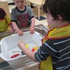 June 4, 2014 - The children add different objects to the water to see what floats or sinks.