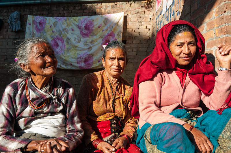 Socializing in the sunshine. Bhaktapur backstreets. Nepal