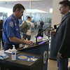 TSA agents check passenger through the security check point at Tulsa International Airport Tuesday.