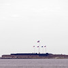 Fort Sumter National Monument<br /> <br /> Perhaps no area in America embraces the evolution of harbor fortifications as well as Fort Sumter National Monument, which includes both Fort Sumter and Fort Moultrie. Strategically located at the mouth of Charleston Harbor, the first Fort Moultrie was the scene of a victory on June 28, 1776 that prevented the British from quenching the American Revolution in its early stages. The second Fort Moultrie occupied almost the same site from 1794-1804 as war clouds in Europe posed numerous threats to America. The third Fort Moultrie, completed in 1811, played its most significant role during the Civil War. On December 26, 1860, Union Major Robert Anderson evacuated the fort to occupy the new Fort Sumter one mile southwest in Charleston Harbor. Fort Sumter was built as a defensive counterpart to Fort Moultrie. The guns at Fort Moultrie helped drive Major Anderson out of the fort during the opening of the Civil War, April 12-13, 1861. As the symbol of secession and Southern resistance, Fort Sumter was heavily damaged by Union rifled guns in 1863-1865, which signaled the end of obsolete masonry forts with many guns. During rehabilitation of these forts in the 1870s, larger guns were spaced further apart, powder magazines built underground and closer to the guns. Batteries Jasper and Huger were built in the Spanish-American War era. These huge concrete structures could withstand the more powerful naval armament. To protect minefields, smaller batteries such as Bingham, McCorkle, and Lord were developed. In World War II, the logical culmination in the evolution of harbor fortifications was the employment of electronic detection equipment of the Harbor Entrance Control Post with nearby defensive guns. The structures of Fort Sumter National Monument, whether large or small, have played a substantial role in safeguarding the Charleston area through nearly 200 years of history and seven wars. Listed in the National Register October 15, 19
