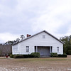 Hampton Colored School<br /> <br /> The Hampton Colored School is significant both as an intact example of twentieth century vernacular school architecture and for its association with black education in Hampton from 1929 to 1947. The building is a one-story, front-gable, rectangular, frame building with clapboard siding, tin roof, exposed rafters, and a brick pier foundation. Ervin Johnson, a local black carpenter, built the school in 1929. It replaced the first black school in Hampton, a two-room building which had operated since 1898. The school board bought a one-acre site for the new school in 1927, and two years later Johnson, along with C.H. Hazel and Hallie Youmans, bought an additional three acres and donated them to the school. Johnson built the two-room (later three-room) school with volunteers from Hampton's black community. When the school opened for the 1929-1930 school year, it served students from first through eighth grade. Initially funds were so scarce that the school only operated from October to March. Donations from the black community eventually made it possible to operate the school for a full academic year. It remained the only black school in Hampton until 1947, when Hampton Colored High School was built and the Hampton Colored School became the lunchroom for the high school. Listed in the National Register February 28, 1991.