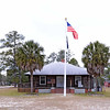 American Legion Hut<br /> <br /> The American Legion Hut is a one-story, T-shaped cypress log building with a truss roof constructed in 1933. The Hut was constructed as and continues to be a meeting hall for the Hampton American Legion Post 108 as well as serving as a site for civic and social events. Local workers built the Hut supported by funds from the Reconstruction Finance Corporation, a federal agency that provided loans for work relief projects during the Great Depression. Construction began on May 8, 1933, and the hut was formally opened to the public on August 2, 1933. The exterior walls of the building were constructed of saddle-notched cypress logs with a white mortar chinking and rest on a brick pier foundation. The hip roof is covered with asphalt shingles. Vaney Bowers and his brother Dee Bowers, both of Hampton County, cut and skinned the cypress logs used to build the cabin. They pulled the logs on mule-driven carts to the construction site. The American Legion Hut in Hampton has served continuously as a meeting place not only for Legion members, but also for community functions such as school dances, town festivals, family reunions, and veterans' remembrance services. Listed in the National Register October 27, 2000.