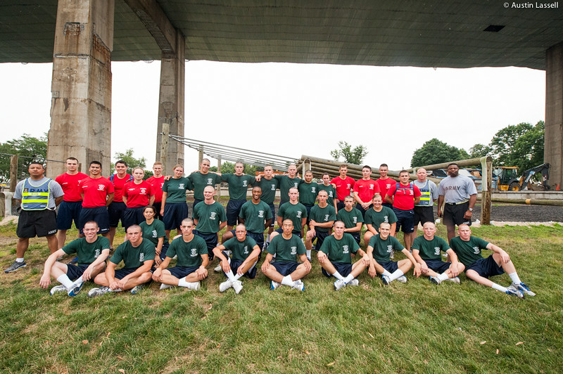 1st Company Platoon 102 candidates pose for a group photo following obstacle course training at SUNY Maritime College on July 14th, 2014.