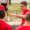 Midshipman Alex Rubio 1st Classman speaks to fellow indoctrination officers as they prepare to lead 4th Company candidates in the next phase of obstacle course training on July 16th, 2014 at SUNY Maritime College.