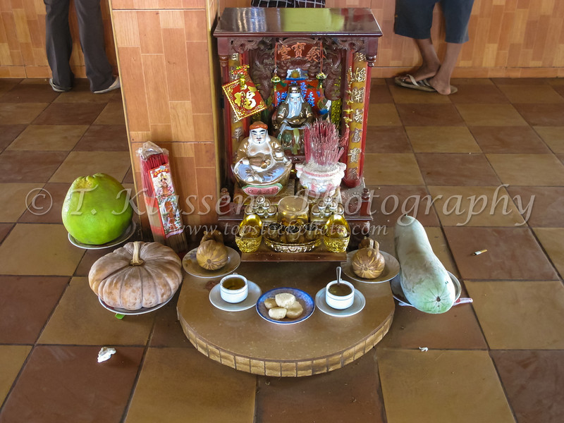 A small buddhist tabletop shrine at the village and insect market in Skun, Cambodia, Asia.