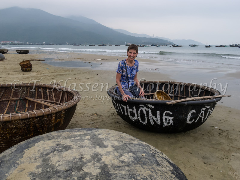 Esther Anne in a bamboo boat at an Eastern China Sea beach, Vietnam, Asia.