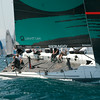 24.07.2011. Sailing Audi MedCup circuit stage from Cagliari, Italy. Region of Sardinia Trophy, class TP 52 series regatta. Quantum Racing of USA. Skipper: Ed Baird. The others boats of the fleet on background.