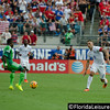 Clint Dempsey (8) - United States Men's National Team challenges Eric Efe Ambrose (green) of Nigeria, EverBank Field, Jacksonville, Florida - 7 June 2014 (Photographer: Nigel Worrall)